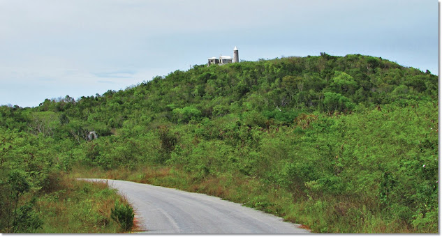 In the distance, a small hermitage sits atop a lush island green hilltop.