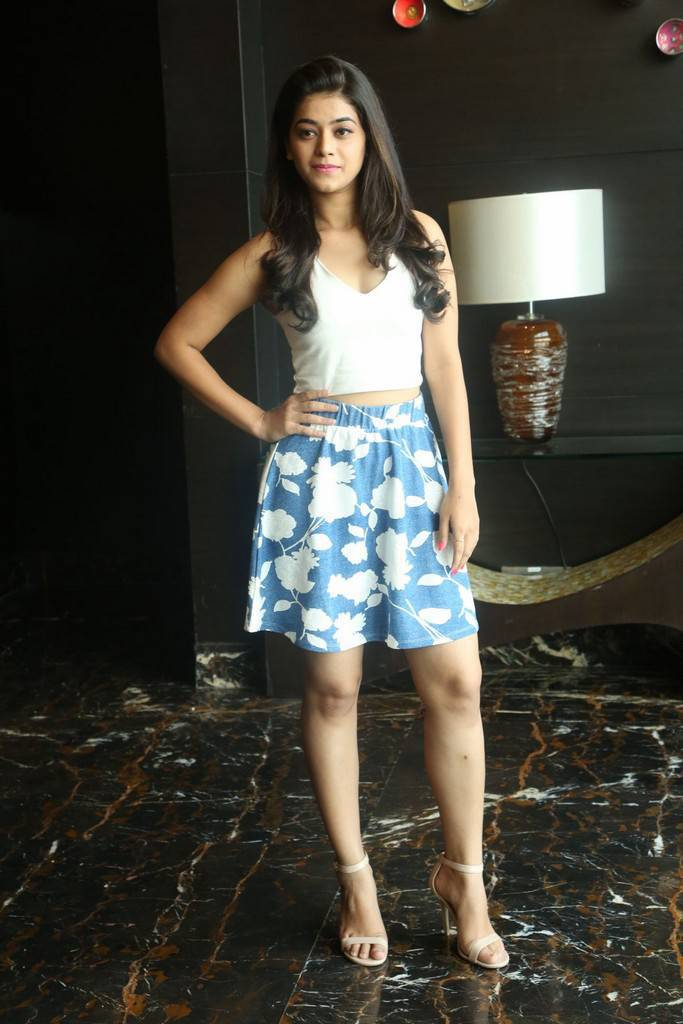 Telugu Actress Yamini Bhaskar Hot Stills In White Mini Skirt