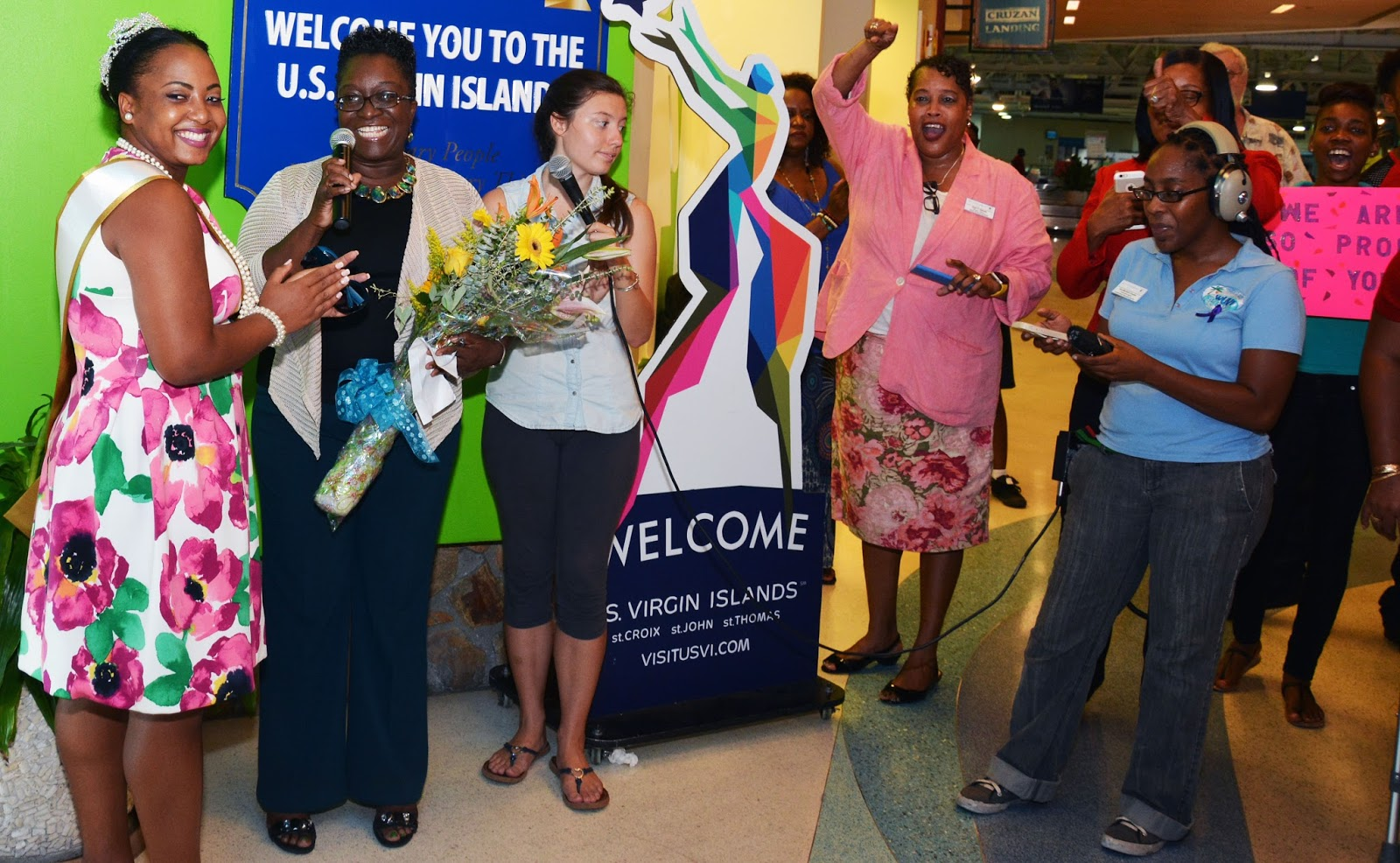 Warner Is Greeted By UVI Supporters At The Airport.