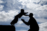 Kid jumping to his father