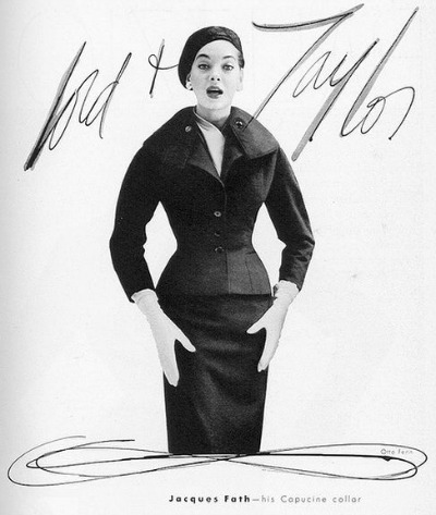 Model in pencil skirt suit with hat for 1954 Jacques Fath ad for Lord & Taylor