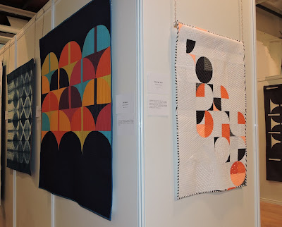Luna Lovequilts - My quilt Orange Pop and Bridges by Anne Sullivan hanging at Patchwork Sitges 2018
