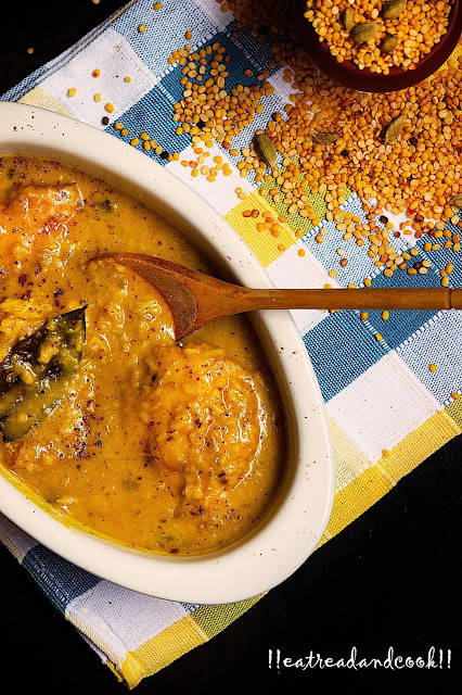 simple and easy bengali moong dal recipe and preparation Bhaja Mug Dal Diye Mach recipe / Moong Dal Fish Curry recipe with step by step pictures
