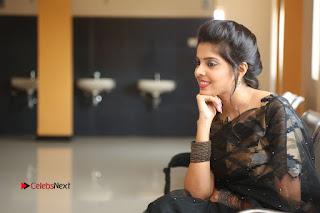 Actress Shravya Pictures in Black Saree at Nandini Nursing Home Audio Success Meet .COM 0197.JPG