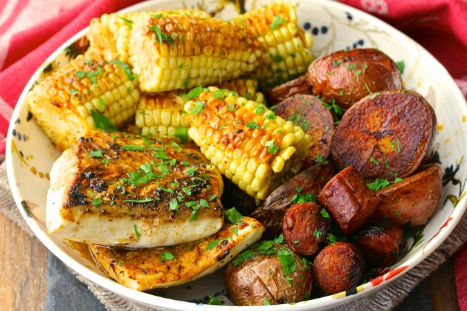 This Halibut with Red Potatoes, Corn, and Sausage Sheet Pan Dinner is an amazing feast.