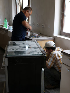 Dad fitting a plug, Bekir looking at the gas pipe