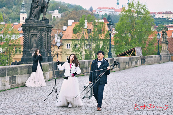 DIY bridal couple, the Charles Bridge in Spring Prague by Travel and Lifestyle Photographer Kent Johnson.