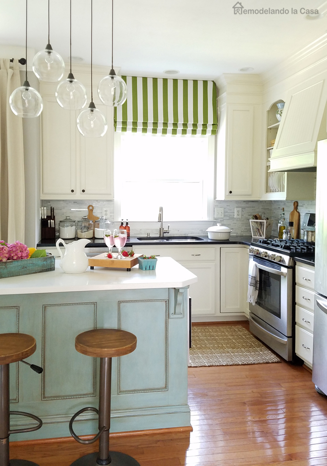 white kitchen with teal kitchen island - painted oak cabinets