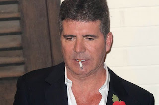 Simon Cowell rushed to the hospital after fainting at home