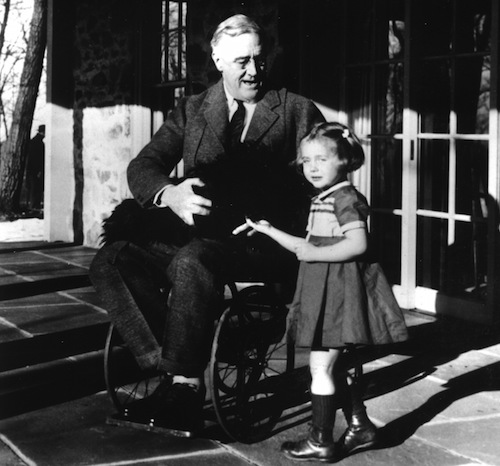 Photo of FDR in wheelchair from 1941 at home with dog and child