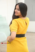 Actress Poojitha Stills in Yellow Short Dress at Darshakudu Movie Teaser Launch .COM 0305.JPG