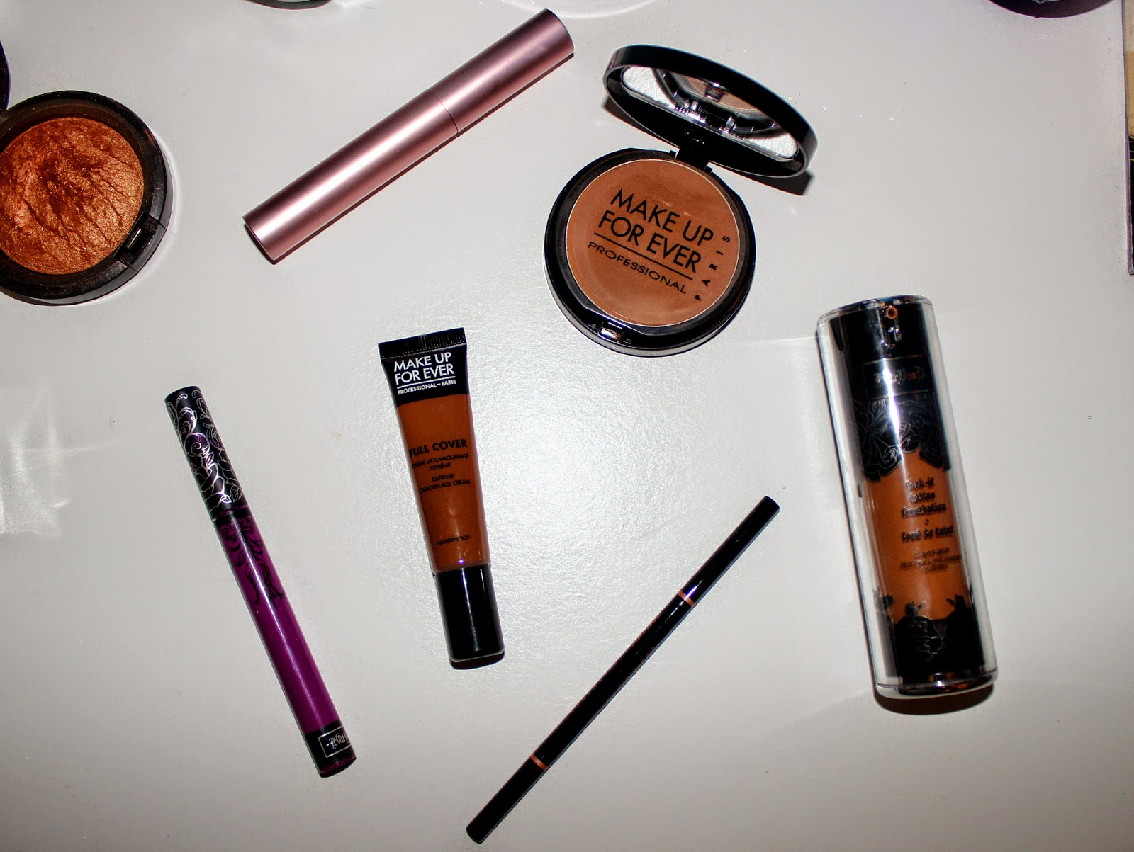 kat von d liquid lipstick kat von d lock it foundation make up for ever full cover concealer too faced better than sex mascara anastasia beverley hills brow whiz