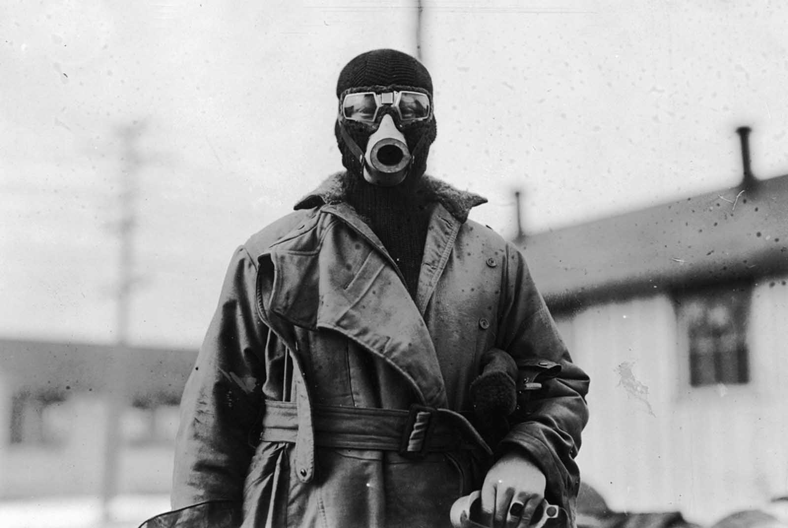 Unidentified pilot wearing a type of breathing apparatus. Image taken by O.I.C Photographic Detachment, Hazelhurst Field, Long Island, New York.