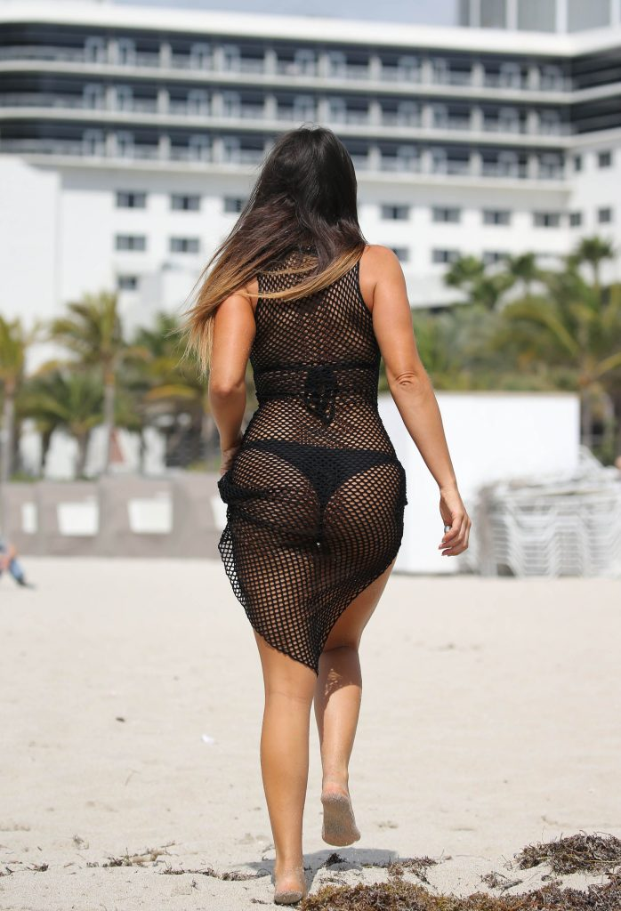 Claudia Romani in black bikini