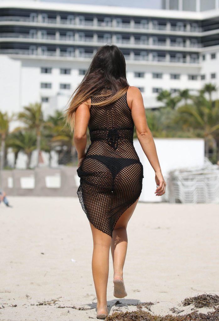 Claudia Romani in black bikini