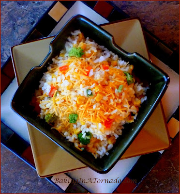 Easy Rice with Vegetables Casserole, a simple side dish put together in minute with cooked rice and chopped vegetables. A great compliment to any meal | Recipe developed by www.BakingInATornado.com | #recipe #dinner