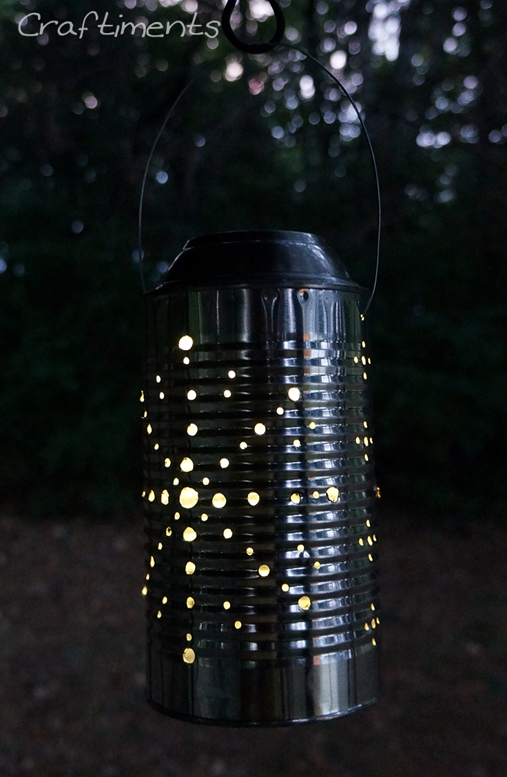 Tin can solar lantern lit up at night.