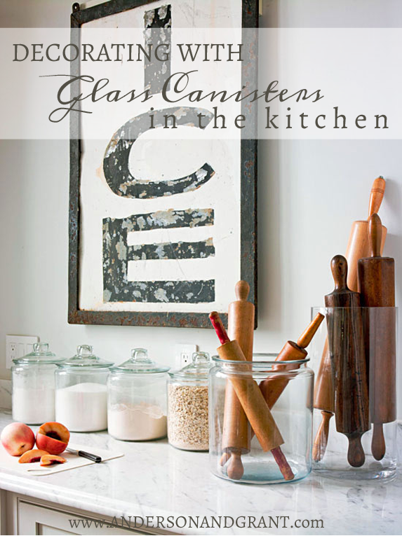 Unlike other rooms, kitchens can be hard to decorate.  Using glass canisters to store essentials like flour and sugar is a great way to add a decorative yet utilitarian touch to the space!  Find inspiration for this decorating tip at www.andersonandgrant.com (Photo via BHG.com)