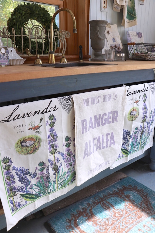 garden-shed-lavender-towels-vintage-grain-sack-under-counter-curtains