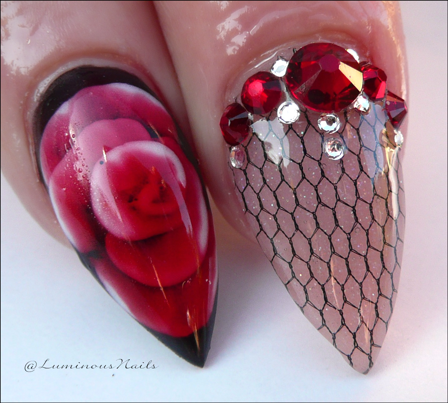 Luminous Nails: Red & Black Acrylic Nails with netting and encased rose