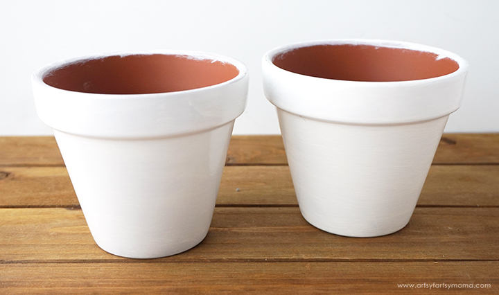 With a little bit of paint, you can turn inexpensive terra cotta pots into trendy DIY Gold Ombre Planters!
