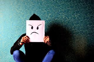 Illustration of a sad face.