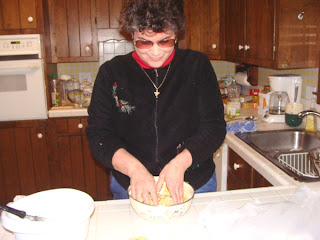 Laurel stirring matzo with hands