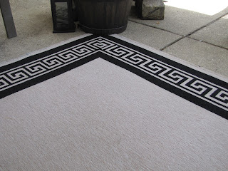 clean outdoor rugs