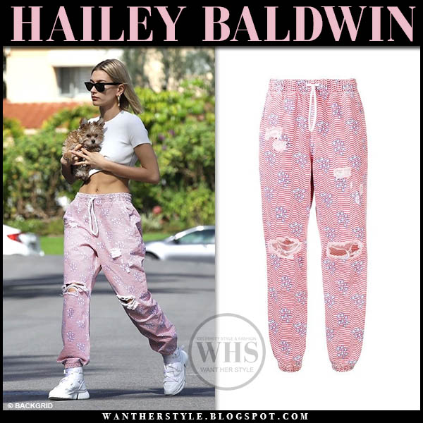 Hailey Baldwin in white crop top and pink distressed pants alexander wang street style january 24