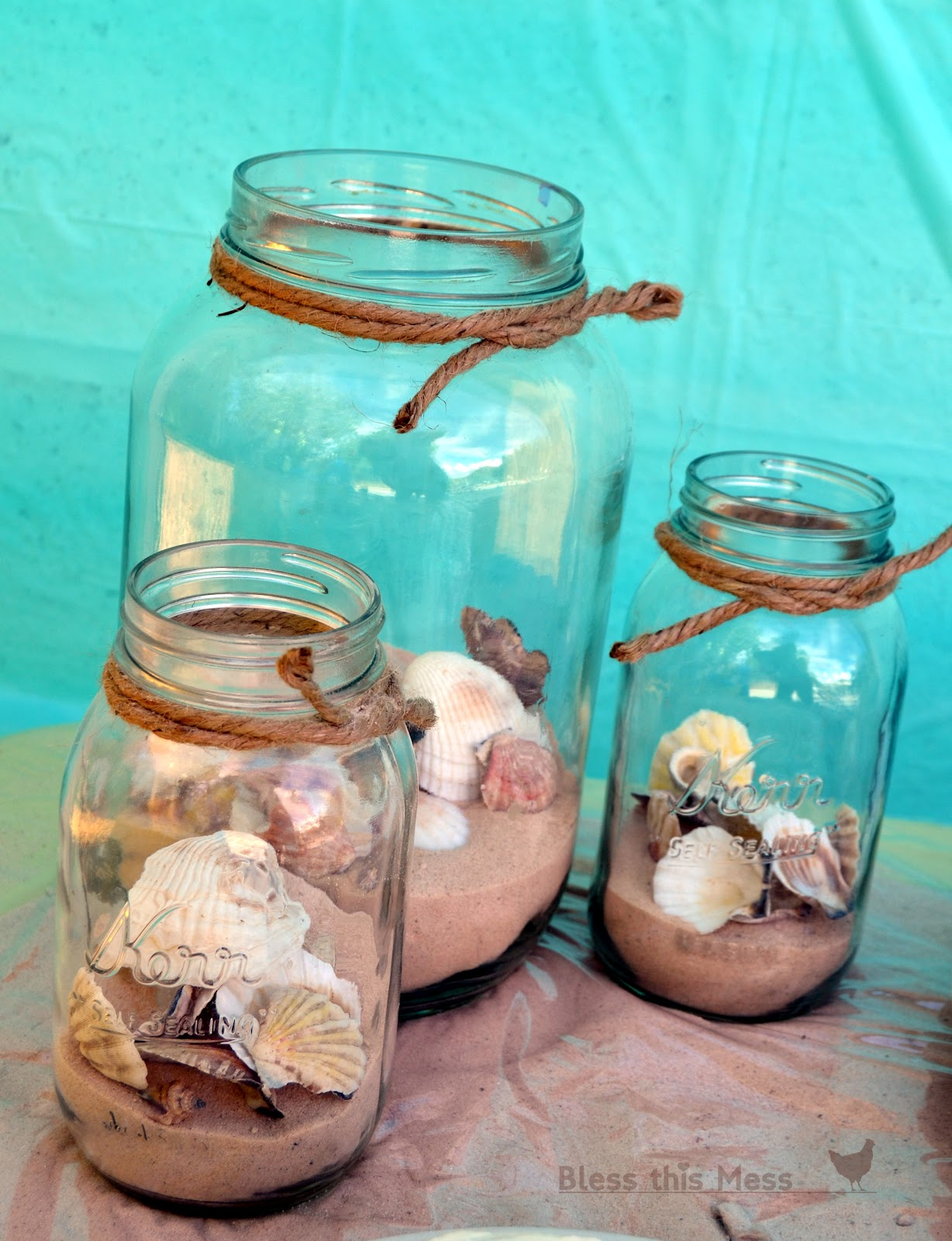 Glass Jars With Sand Seashells And Rope