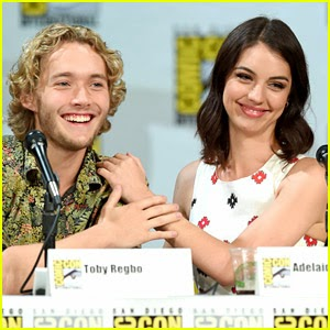 CW Reign at SDCC 14 panel. Hot, sexy brunette in designer dress. Celebrity romance, on-screen hookups,