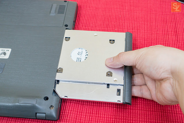 insert back hdd caddy into laptop
