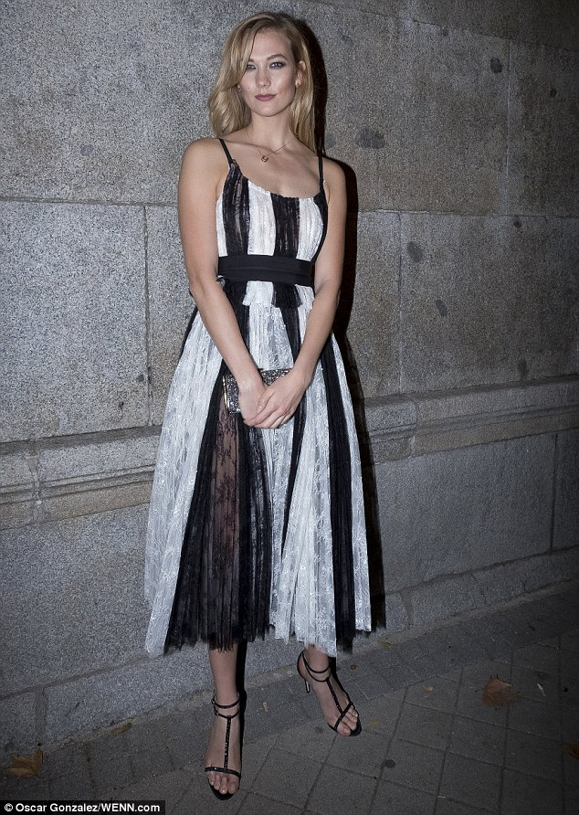 Karlie Kloss stuns in chic lace dress at the Carolina Herrera fashion celebration in Madrid