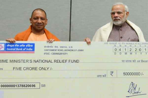 cm-yogi-donate-rs-5-crore-cheque-to-pm-fund-for-ockhi-cyclone