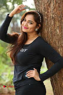 Actress Aswini Latest Stills in Black Denim Jeans  0157.JPG