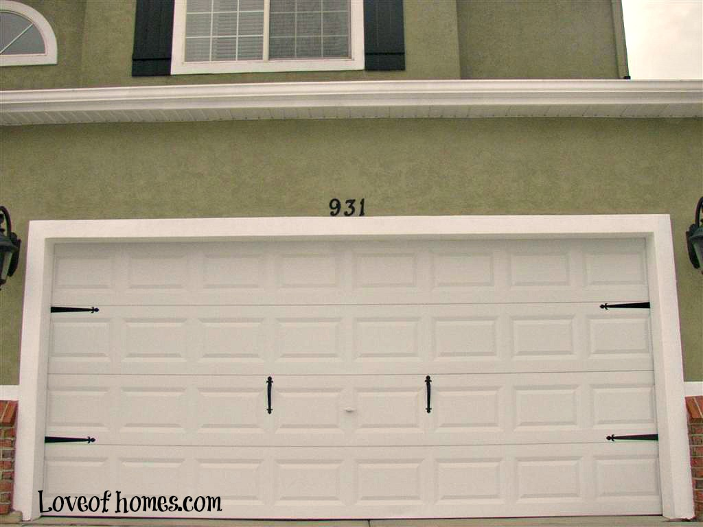 Love of homes garage doors my husband says its fine because they are two different sized doors rubansaba