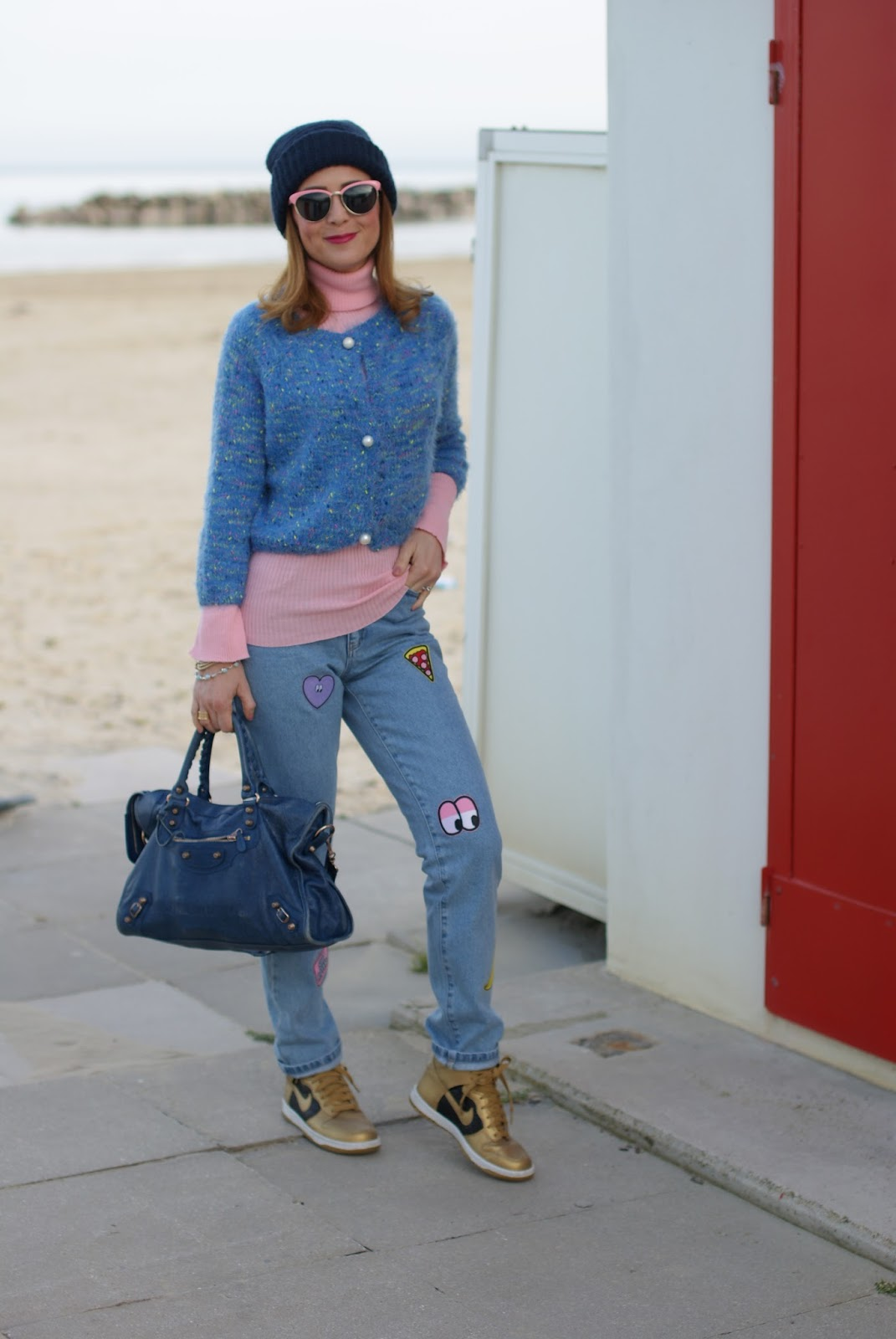 the raggest priest Mom patched jeans, pink turtleneck, Balenciaga bag on Fashion and Cookies fashion blog, fashion blogger style