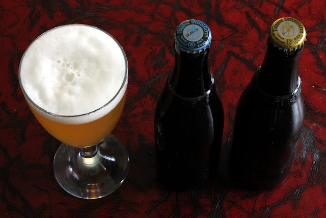 A glass of homebrewed Westvleteren Blond, and an 8 and 12.