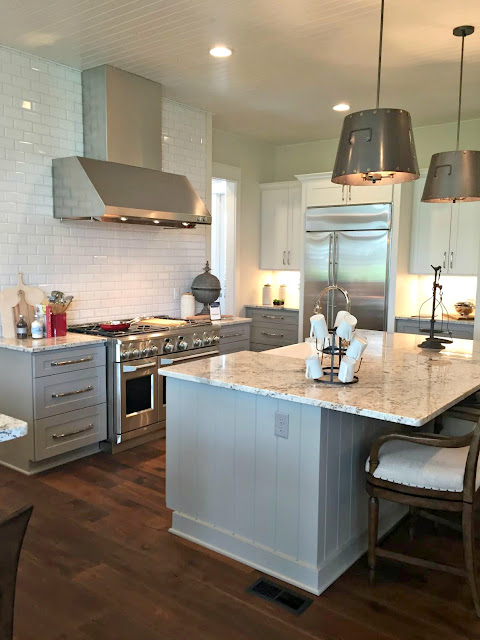 white tile light gray cabinets