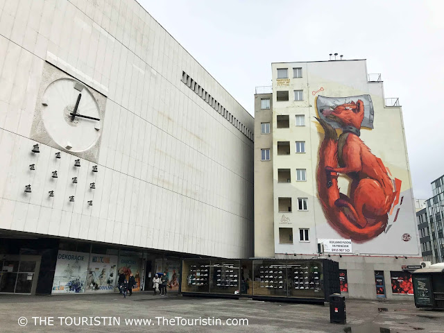 Fat Heat Fox Street Art on a facade of a high rise in Bratislava in Slovakia