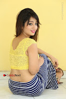 Cute Telugu Actress Shunaya Solanki High Definition Spicy Pos in Yellow Top and Skirt  0382.JPG