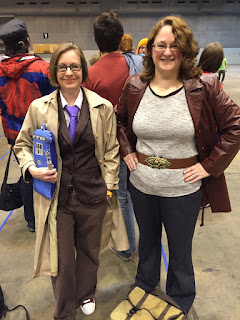 Amanda in her 10th Doctor cosplay, me in my Donna Noble cosplay, waiting to enter the convention hall.