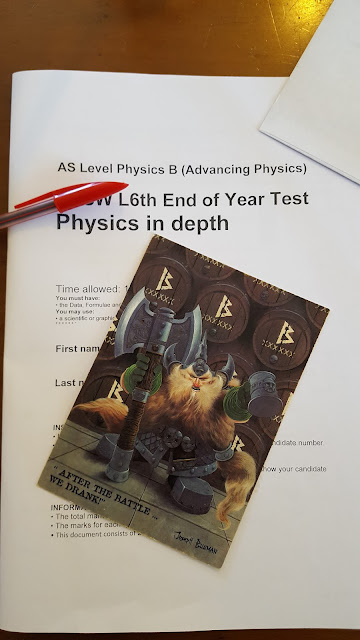 bugman's brewery birthday card on top of a physics a level exam