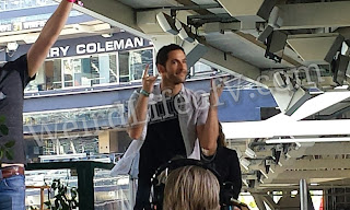 Tom Ellis greeting the fans as he arrives on stage