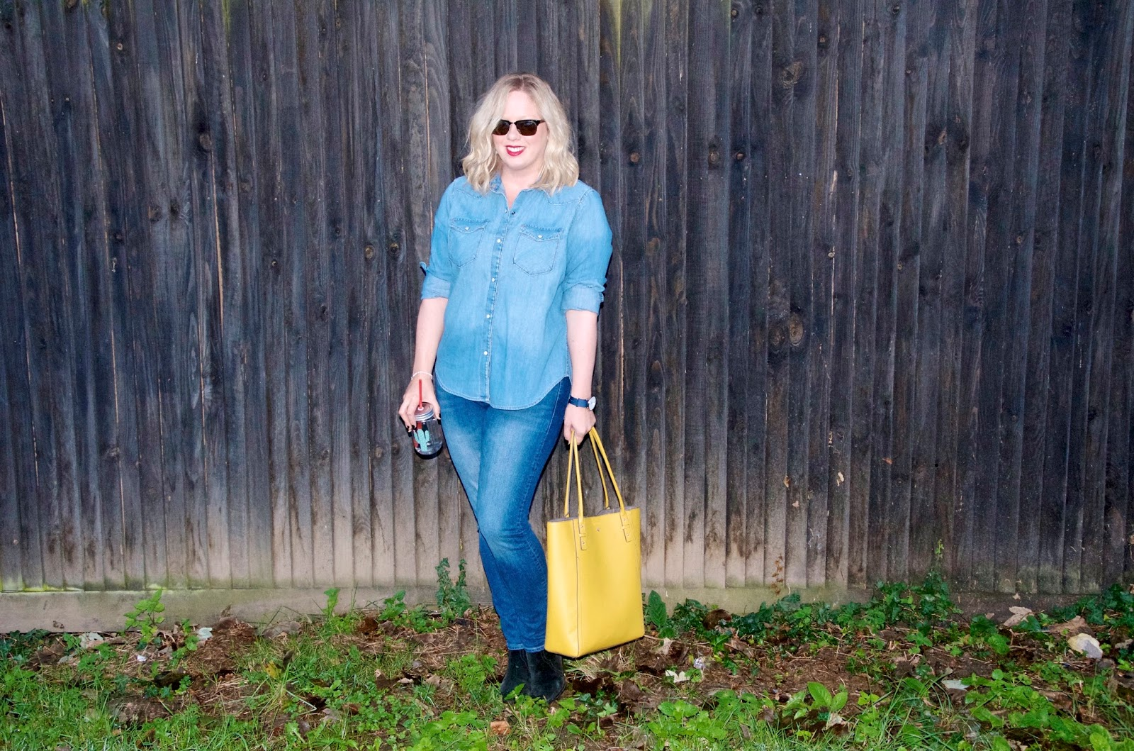 Denim western style shirt with skinny jeans and yellow bag