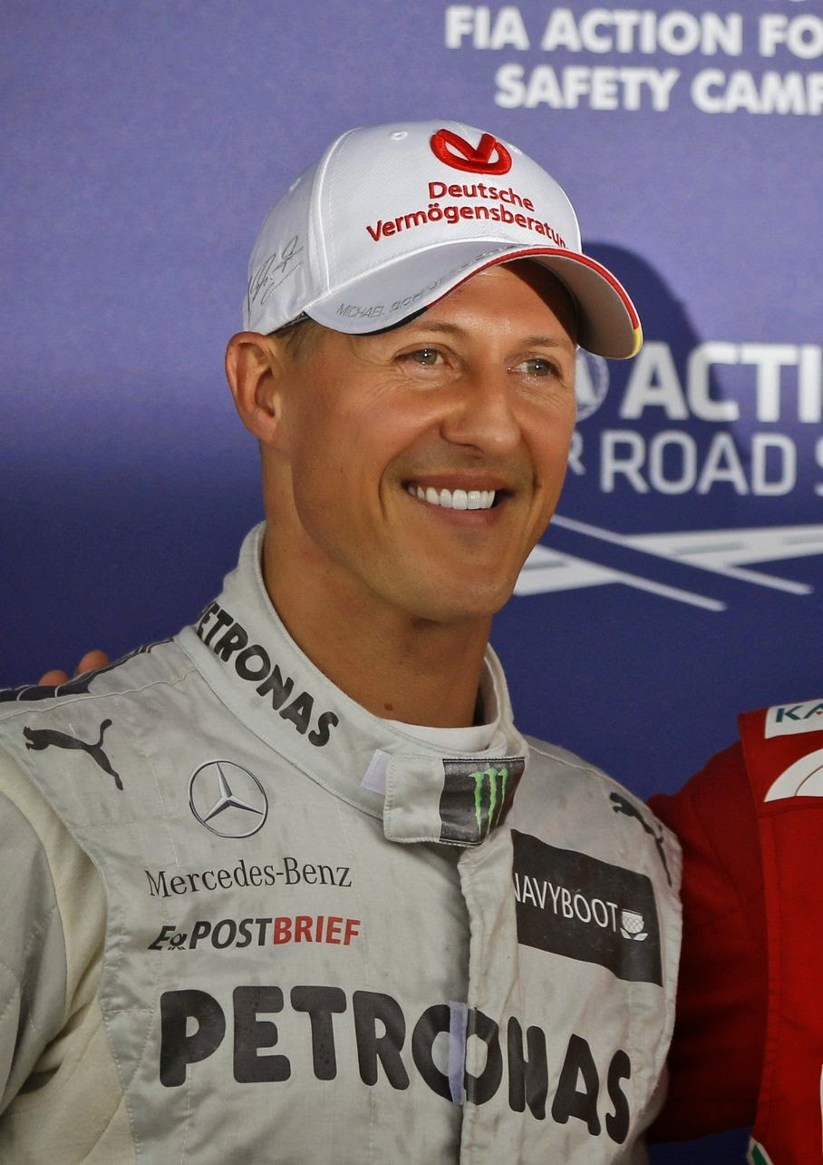 "Michael Schumacher poses for the photographers at the Silverstone circuit in England, in this Saturday, July 7, 2012 file photo. Schumacher's manager says the Formula One great is no longer in a coma and has left a French hospital where he had been receiving treatment since a skiing accident in December. Manager Sabine Kehm says in a statement Monday, June 16, 2014, that Schumacher has left the hospital in Grenoble ""to continue his long phase of rehabilitation."" The statement did not say where the seven-time F1 champion was taken or give any details of his condition."