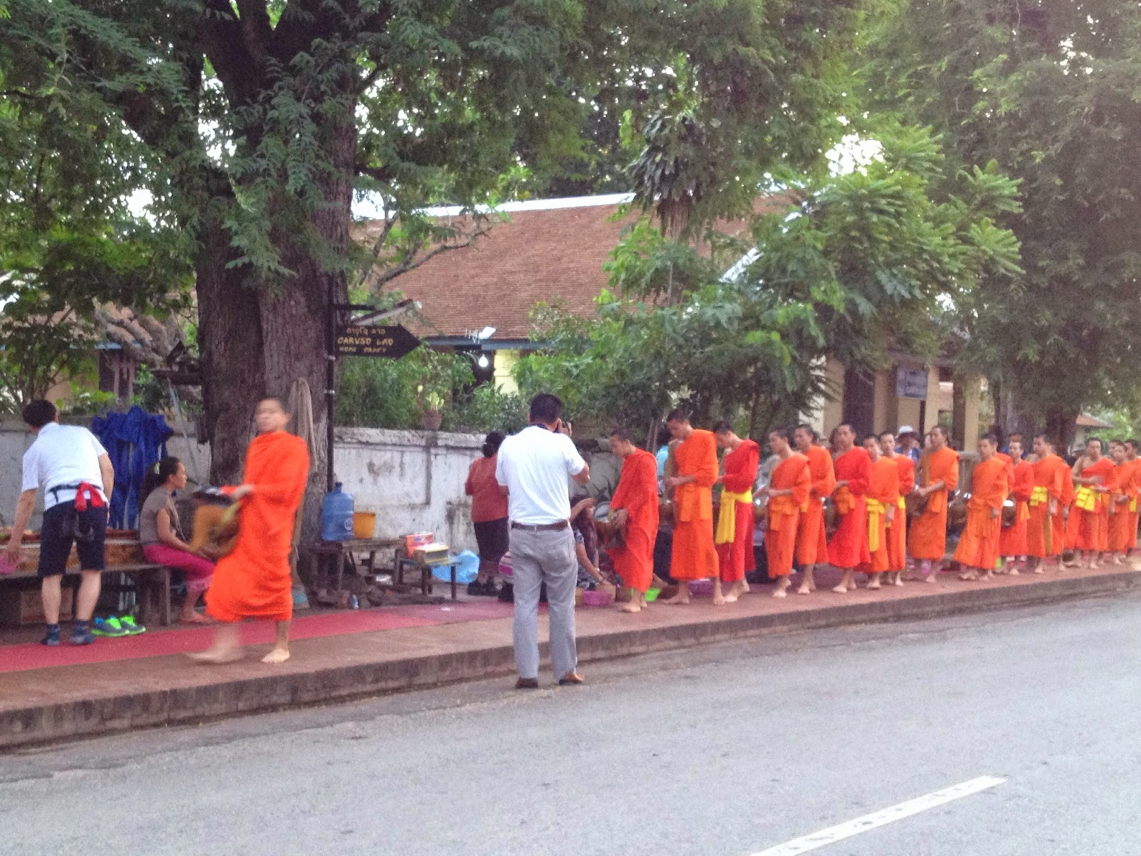 Luang Prabang - Some tourists got really close to the monks to snap photos