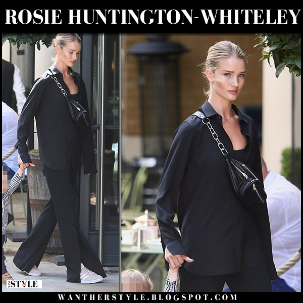 Rosie Huntington-Whiteley in black shirt and black flared split front a.l.c. pants model street style august 23