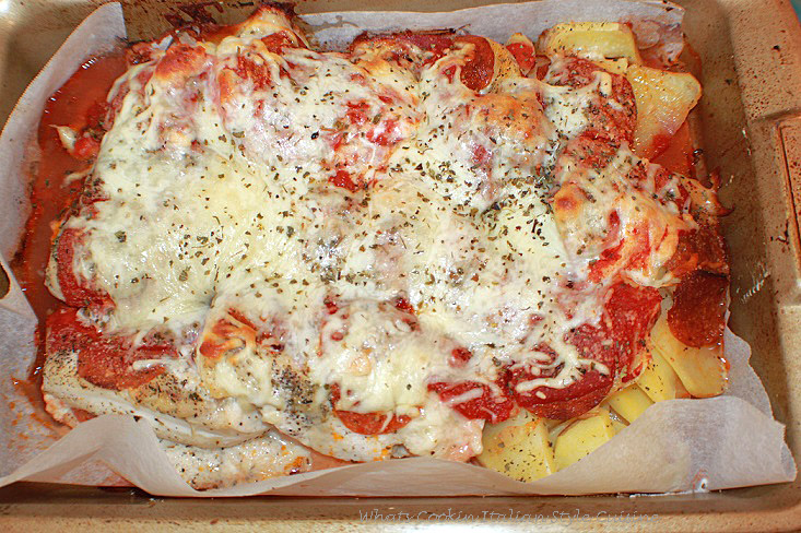 this is a pan of chicken and potatoes make like a pizza all in one pan easy meal. It is topped with mozzarella cheese and baked until crispy. Pepperoni is also added.