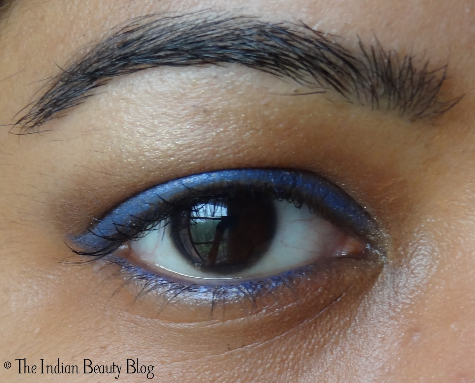 Copper-brown eye make-up with blue eyeliner and kohl: make ... - photo#11